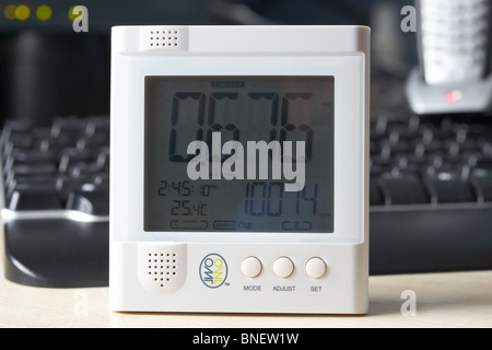 using a wireless electricity monitor to monitor electricity usage in a home office environment in the uk - Stock Photo