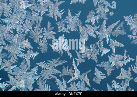 Ice crystals from humidity condensation forming outside a window glass under extremely cold temperatures, Kuhmo, - Stock Photo