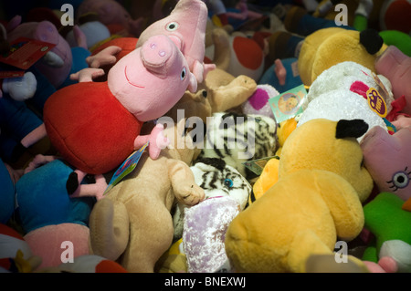 Close up of soft toys in arcade machine,Fisher-Price to make toy range with potential to bring in $1bn a year Peppa - Stock Photo
