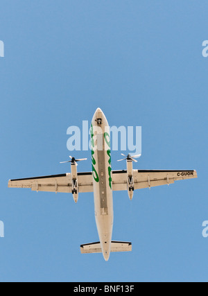 Looking straight up at an Air Canada Jazz Dash-8 commercial airliner on final approach for landing . - Stock Photo