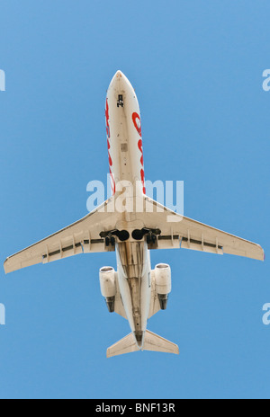 Looking straight up at an Air Canada Jazz CRJ-100ER commercial jet airliner on final approach for landing . - Stock Photo