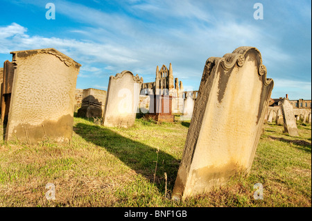 St. Mary's church graveyard Whitby, with the abbey in the background - Stock Photo