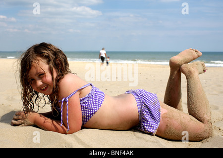 Young Girl Lying on Beach. Model Released - Stock Photo
