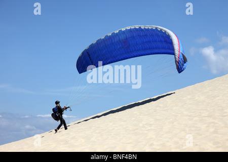 Paraglider Ascending the Dunes du Pyla Near Arachon France - Stock Photo