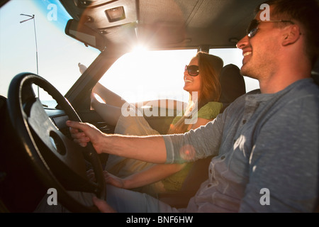 Couple with oldtimer by sea - Stock Photo