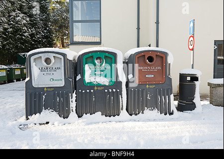 Glass Recycling Rubbish Containers in the snow - Stock Photo
