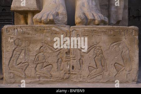 Temple of Ramses III. Relief depicting Ramses III with war prisoners. Egypt. - Stock Photo