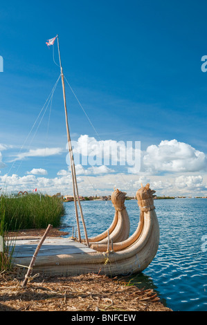 Two reed boats on Uros floating Islands in Lake Titicaca, Peru, South America. - Stock Photo