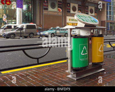 Double waste bin on the street of central Shanghai, China - Stock Photo