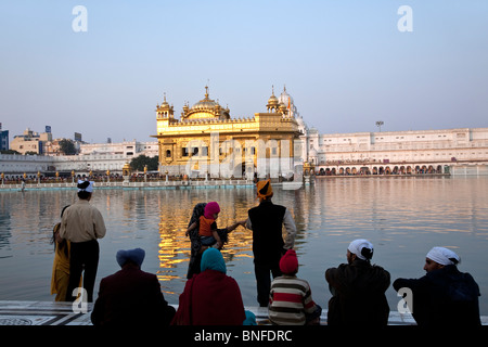 Sikh pilgrims worshiping the Golden Temple. Amritsar. Punjab. India - Stock Photo