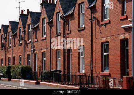 Brick-built terraced houses in street in Dumfries, Scotland. - Stock Photo