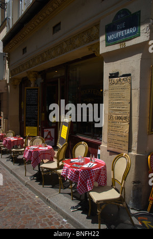 Empty street cafe Rue Mouffetard street Latin Quarter Paris France Europe - Stock Photo