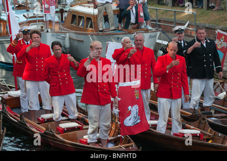 Swan Upping on River Thames. The Queen's Swan Marker David Barber and his uppers along with others drink the loyal - Stock Photo
