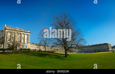 The 'Royal Crescent' in the historic, planned Georgian city of Bath in the UK on a Sunny day with open lawns and - Stock Photo