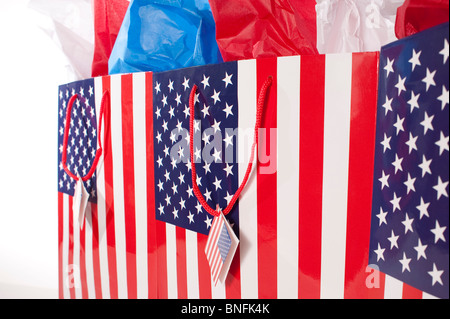 Shopping American Flag gift bags with red,white and blue tissue - Stock Photo
