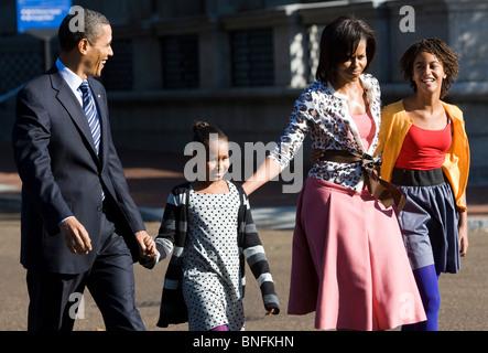 President Barack Obama, First Lady Michelle and daughters Sasha and Malia walk along Pennsylvania Avenue.  Stock Photo