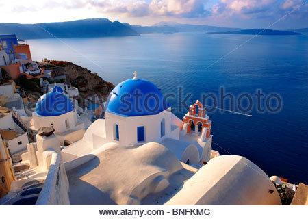 Typical traditional blue domed church of Oia, Santorini ( Thira ) Island Greece - Stock Photo