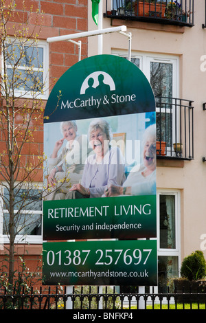 McCarthy and Stone sign outside housing development in Dumfries, Scotland. - Stock Photo