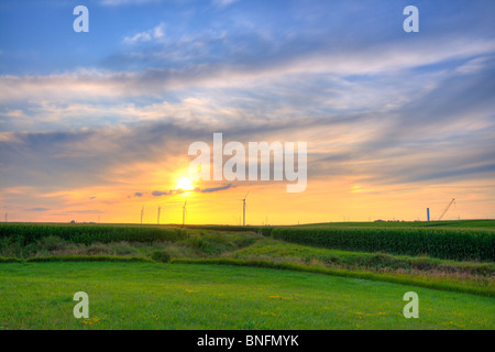 Windmills at sunset in Central Indiana - Stock Photo