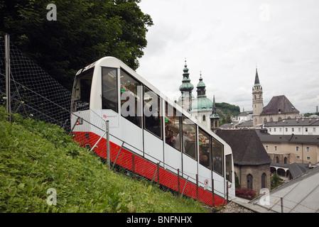 Salzburg, Austria, Europe. Festungsbahn Funicular railway carrying passengers down from Hohensalzburg Castle - Stock Photo