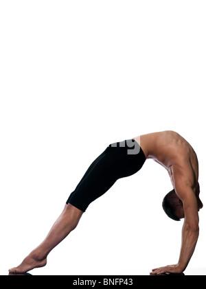 caucasian man sarvangasana setu bandha bridge pose yoga gymnastic stretching bend isolated studio on white background - Stock Photo