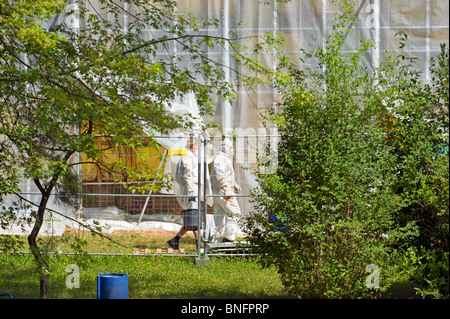 man and nature asbest Asbestos disposal dumping cleaning disposing removal full inherited waste polluted areas protective - Stock Photo