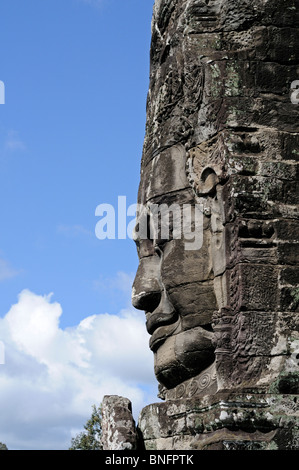 Giant carved stone face of Lokeshvara at Bayon Temple of Angkor Thom, Cambodia