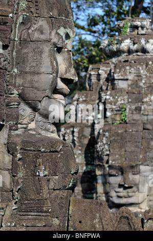 Giant carved stone faces of Lokeshvara, Bayon Temple, Angkor Thom, Cambodia