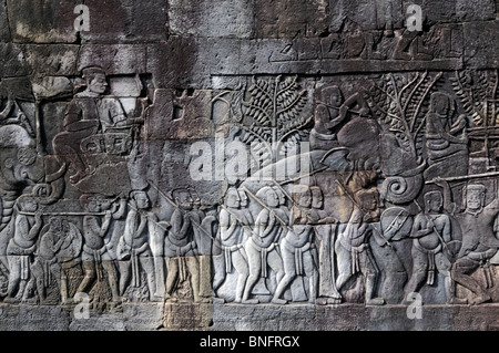 Detail of bas relief at the Bayon Temple showing Khmer warriors, Angkor Thom, Cambodia - Stock Photo