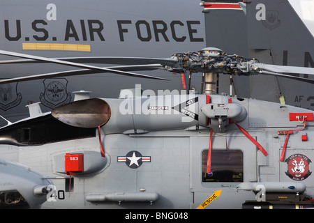 Assorted military aircraft (Sikorsky's MH-60R Seahawk in foreground) at the Farnborough Airshow. - Stock Photo