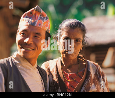 Husband and wife in their home village on the Annapurna trail in west-central Nepal - Stock Photo