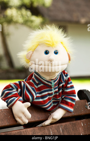 Blond spiky hair puppet. - Stock Photo