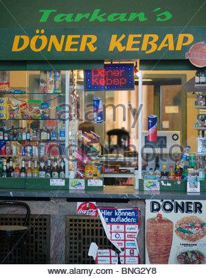 Turkish Doner Kebab seller at German railway station - Stock Photo