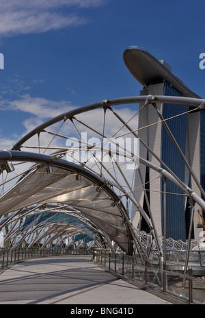 Marina Bay Sands, Singapore viewed through the Helix Bridge - Stock Photo