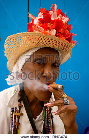 old woman smoking a Cuban cigar,Havana,Cuba - Stock Photo