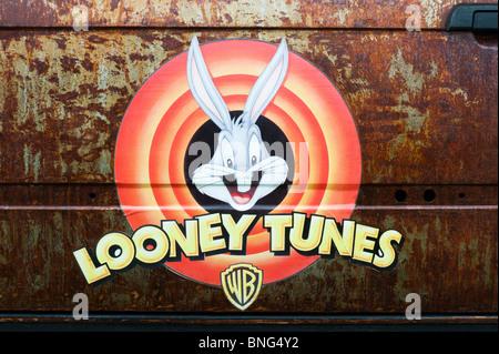 Looney tunes sticker on a rusty rat car door at the Santa Pod Retro show 2010 - Stock Photo