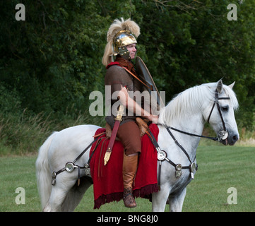 Roman Cavalry soldier on a white horse at a historical reenactment living history display - Stock Photo