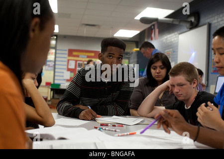 Students in physics class at Manor New Tech High School in Manor, Texas, work together on a  class problem - Stock Photo