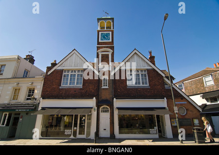 Horizontal wide angle of distinctive double fronted architecture with a clock tower on Wimbledon High Street in - Stock Photo