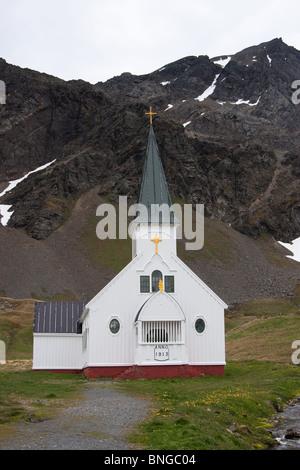 The Norwegian Church beside a stream in Grytviken, on South Georgia Island - Stock Photo