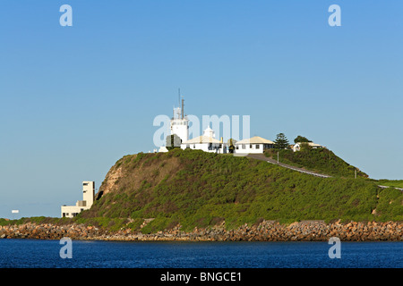 Nobby's Head Lighthouse is located on the Hunter River at the entrance to the port of Newcastle, NSW, Australia - Stock Photo
