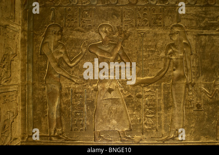 Ptolemaic temple of Hathor and Maat. Male figure flanked by Maat, with ostrich feather headdress. Deir el-Medina. - Stock Photo