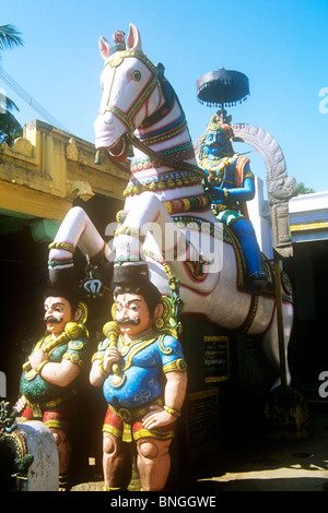 Hindu temple guardians in Tamil Nadu with Aiynar riding a horse - Stock Photo