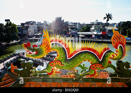 Dragon statue on roof top.  in Kaohsiung City, Sothern Taiwan - Stock Photo