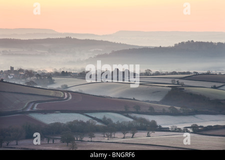 Overlooking frost and mist covered countryside at dawn near the village of Silverton, Devon, England. Winter (March) - Stock Photo