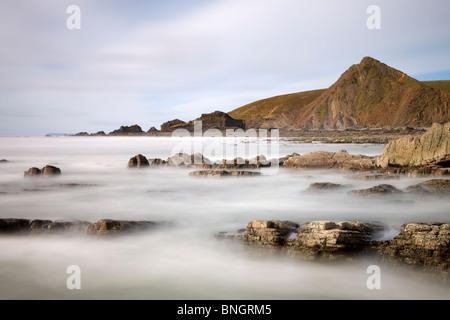 Rocky shores of Spekes Mill Mouth beach on the rugged North Devon Coast, Devon, England. Spring (April) 2010. - Stock Photo