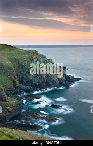 Sunrise above the headland at Hot Point on the Lizard Peninsula, Cornwall, England. Spring (April) 2010. - Stock Photo