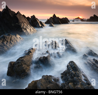 Dramatic coastal scenery at sunset, Hartland Quay, North Devon, England. Spring (April) 2010. - Stock Photo