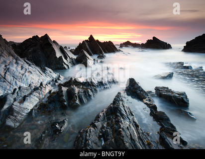 Dramatic coastal scenery at sunset, Hartland Quay, North Devon, England. Spring (April) 2010 - Stock Photo