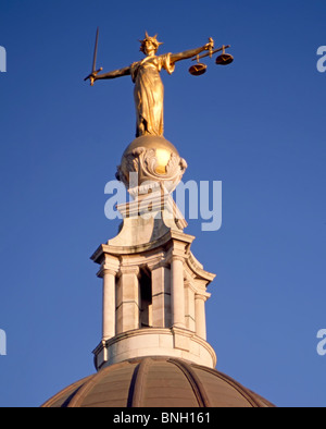 Bronze statue sculpture Lady Justice or Scales of Justice holding sword above Old Bailey courthouse Central Criminal - Stock Photo